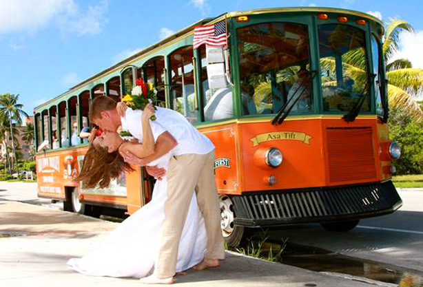 Bride and groom in front of a Key West Trolly