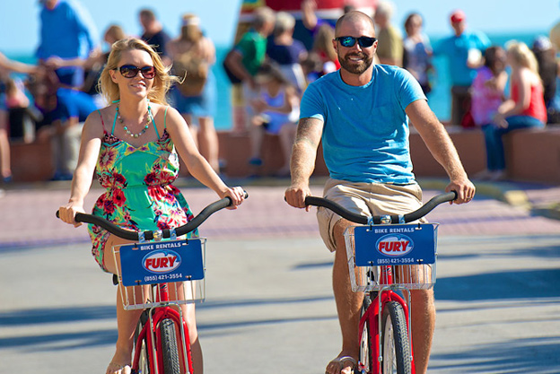 couple riding bike rentals in key west